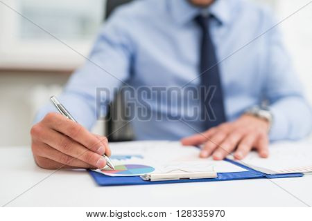 Detail of a businessman writing on a document
