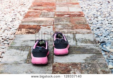 Running shoes in home garden foot path, stock photo