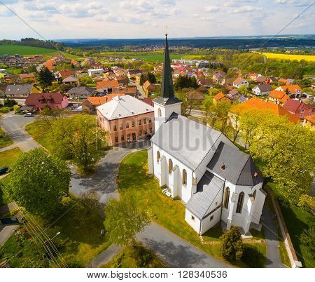 Evening over gothic church St. Peter and Paul in The Litice suburb of Pilsen. Aerial view to romantic citiscape in Czech Republic, Central Europe.