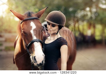 Happy Woman with her Horse - Beautiful young horsewoman next to her horse
