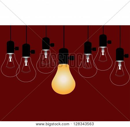 Bright Spot  - Lighted light bulb among a group of unlighted lamps