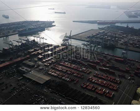 Aerial view of dock with cargo containers for shipping in Los Angeles, California.