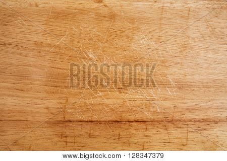 Old scratched wooden cutting board texture background