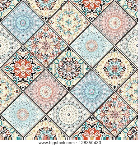 Rich tile ornament from colorful mandalas. Seamless pattern in oriental style. Square tile patchwork design. Intricate tile pattern. Boho chic tile pattern for fashion fabric, furniture, wallpaper.