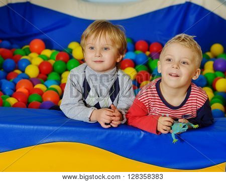 two toddlers boys playing in ball pool