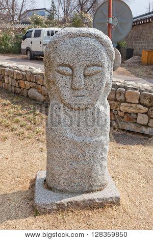 SEOUL SOUTH KOREA - MARCH 14 2016: Replica of Seokjangseung from Deongmok-ri settlement in National Folk Museum of Korea in Seoul. Seokjangseung is a traditional Korean totem pole