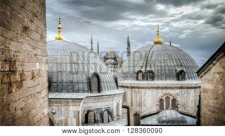 Blue Mosque through the domes of HagiaSophia in Sultanahmet Istanbul Turkey