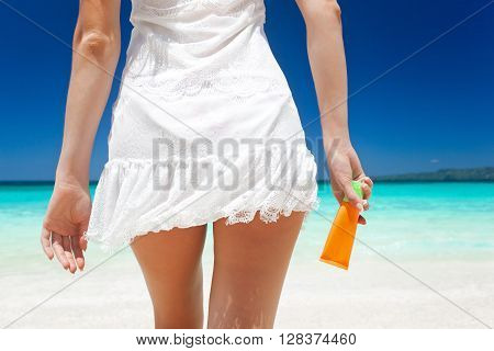 Portrait Of Woman Holding Sunscreen Cream