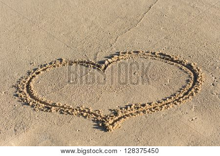 Shape Of Heart On Sandy Beach