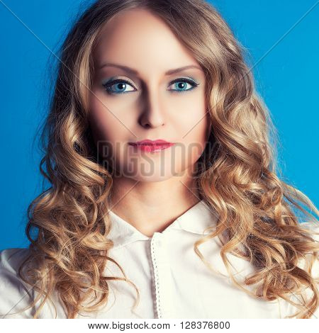 Youn business woman portrait on a blue background