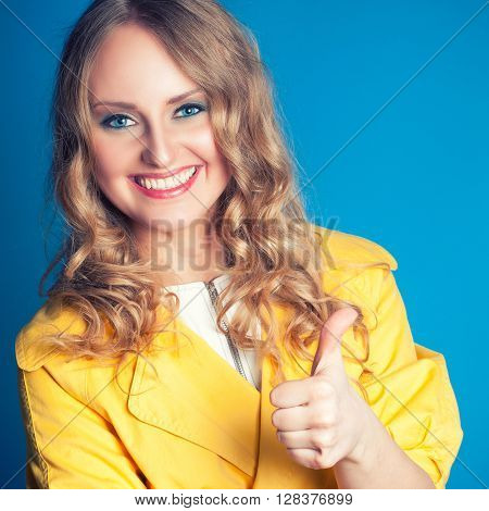 Beautiful And Happy Woman With Thumbs Up
