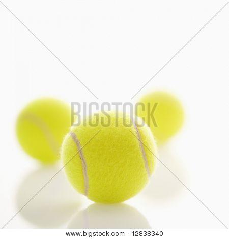 Three tennis balls.