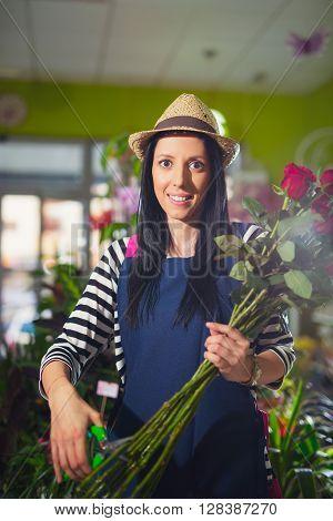 Smiling Woman Florist Small Business Flower Shop Owner. Selective Focus