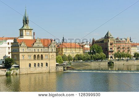 The view of Smetanovo Embankment and Bedrich's Smetana museum in Prague at sunny summer midday