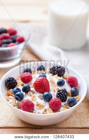 Healthy And Nutritious Yoghurt With Cereal And Fresh Raw Berries