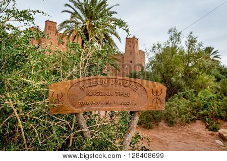 AIT BEN HADDOU MOROCCO - OCTOBER 23 2015: Entrance sign of Kasbah Tebi at Ait Ben Haddou in Morocco.