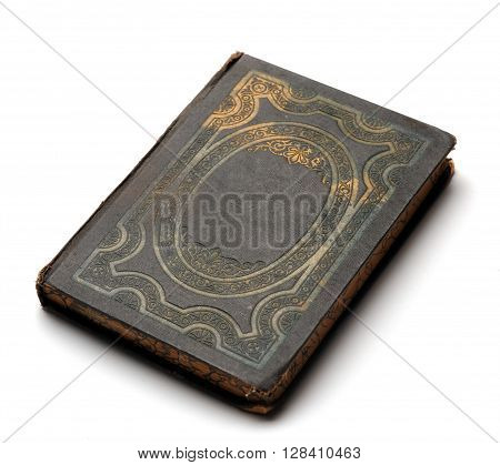 Vintage grunge book with decorated cover at white