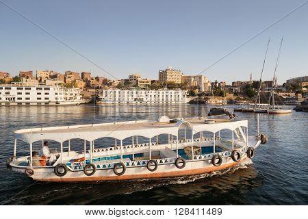 ASWAN, EGYPT - FEBRUARY 5, 2016: Tourist boat on Nile.