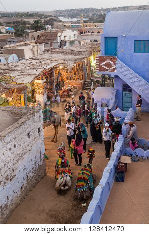 ASWAN, EGYPT - FEBRUARY 5, 2016: Aerial view of traditional houses and people on streets of Nubian village.