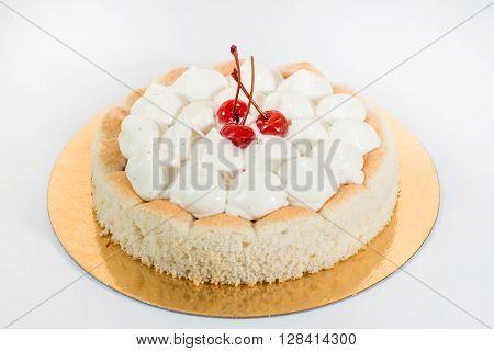 delicious tart with caramel cream and maraschino cherry