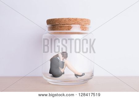 business woman feel unhappy and imprisoned in jar with white wall background great for your design or text asian
