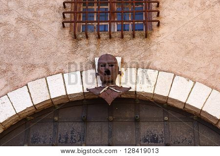 Cannes, France - May 22: This is Iron Mask the real historic French prisoner over the gate of the castle of Castres May 22, 2015 in Cannes, France.