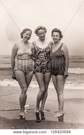 Vintage photo of three women on beach (1950's)