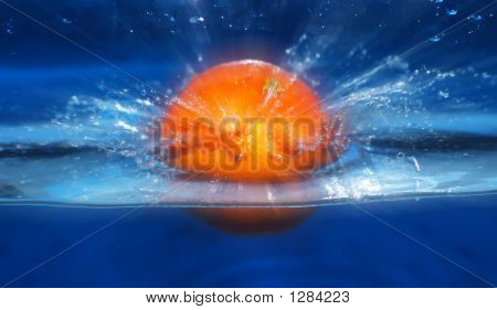 Orange Splashing In Water Blue Background
