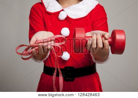 Asian Christmas Girl With Santa Claus Clothes , Measuring Tape And Dumbbell