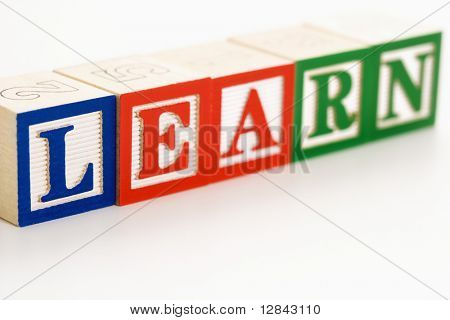 Alphabet toy building blocks spelling the word learn.