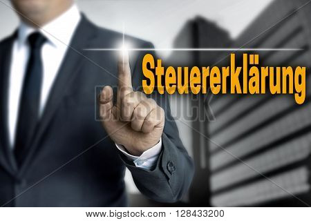 Steuererklaerung (in German Tax Declaration) Touchscreen Is Operated By Businessman