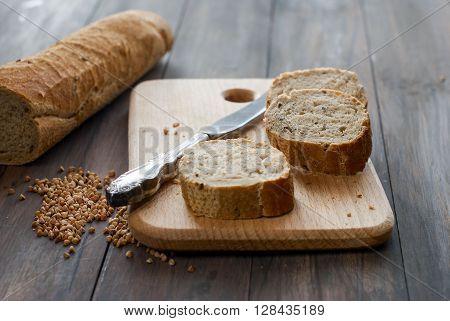 Buckwheat Bread With Buckwheat On A Wooden Table