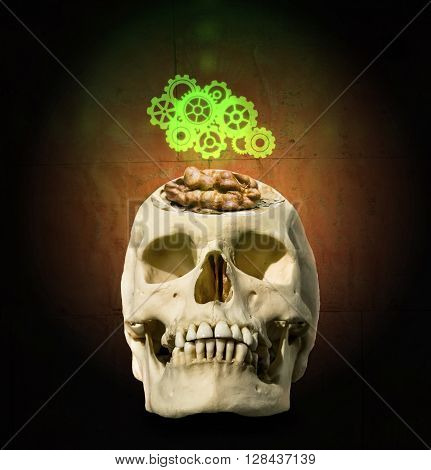 The glowing mechanism of gear over the open skull with the brain in the form of a walnut