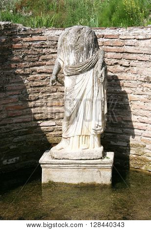 The statue of the goddess Isis Tyche. Archaeological park Dion. Greece