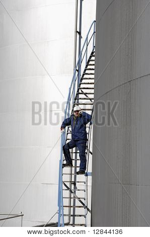industry worker and fuel tanks