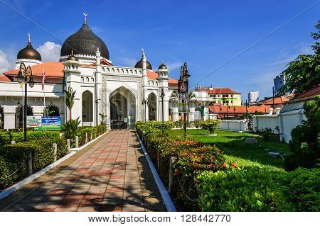 Penang Malaysia - September 3 2013: Front entrance & gardens of Kapitan Keling Mosque a prominent Islamic historic center built by Indian muslim traders in 19th century in historic George Town, Penang.
