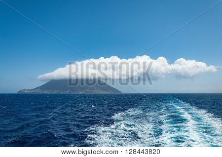 Stromboli island with cloud on the top. Italy.