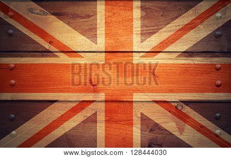 A grunge United Kingdom flag on wooden background