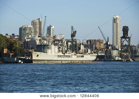 Tanker ship at port in Sydney, Australia with view of buildings.