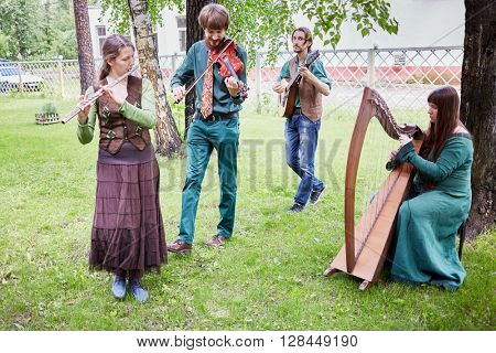 MOSCOW, RUSSIA - MAY 30, 2015: Musical Band Polca an Ri plays music outdoor in park on summer day. Polca an Ri plays traditional irish music.