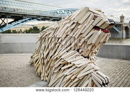 MOSCOW, RUSSIA - JUN 29, 2015: Unique wooden sculpture of a dog breed Komondor by Gabor Miklos Szoke, internationally known sculptor, on Pushkinskaya Embankment in Gorky Park.