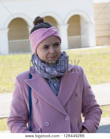 Young Girl In A Pink Coat And Pink Headband