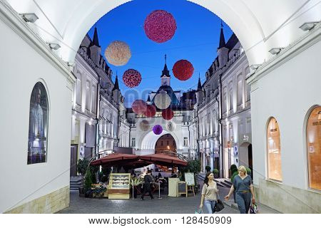 MOSCOW, RUSSIA - JUN 22, 2015: Outdoor cafe and boutiques in Tretyakovsky proezd. Street was built in the 1870-s by brothers-sponsors Tretyakov.