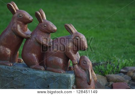 Conceptual sculpture of four rabbit rescue another rabbit out of the water Sculpture of four rabbits are rescue another rabbit out of the water. Limpopo Zoo Nizhny Novgorod