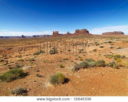 Scenic desert landforms in distance of landscape.