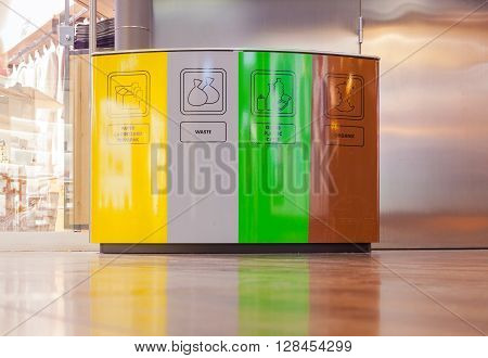 View of colorful recycling and garbage bins