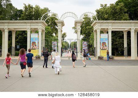 MOSCOW, RUSSIA - JUN 26, 2015: People walk to Sokolniki park through restorated main entrance.