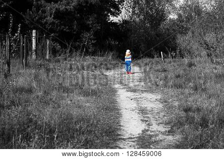 Colored Little Girl On The Threshold Of A Dark Forest Black And White