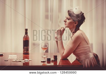 Woman In Veil Is Playing Poker With The Glass Of Whiskey.
