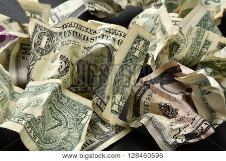 A pile of crumpled money concept of too much money or its worthlessness